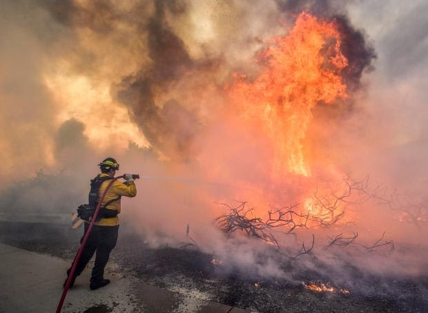IRVINE, CA - OCTOBER 26: Crews battle flames along The 241 Toll Road at Portola Parkway during the Silverado Fire in Irvine, CA, on Monday, October 26, 2020. (Photo by Jeff Gritchen, Orange County Register/SCNG)